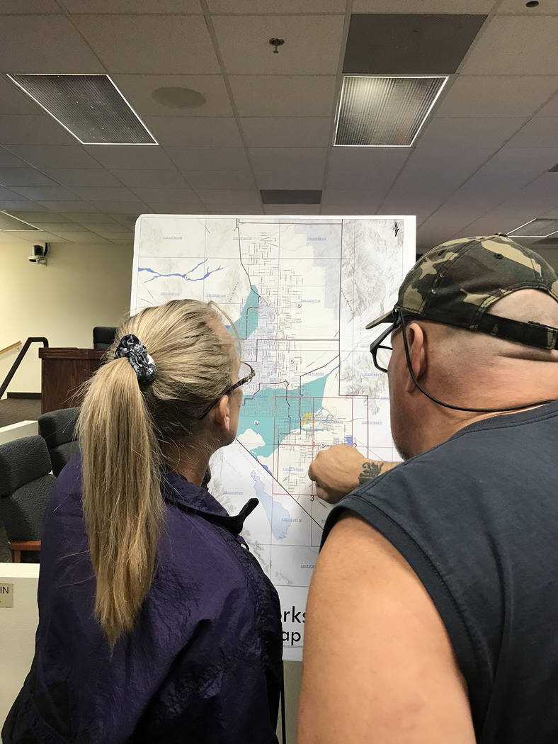 Robin Hebrock/Pahrump Valley Times Two Pahrump residents are pictured observing one of the maps ...