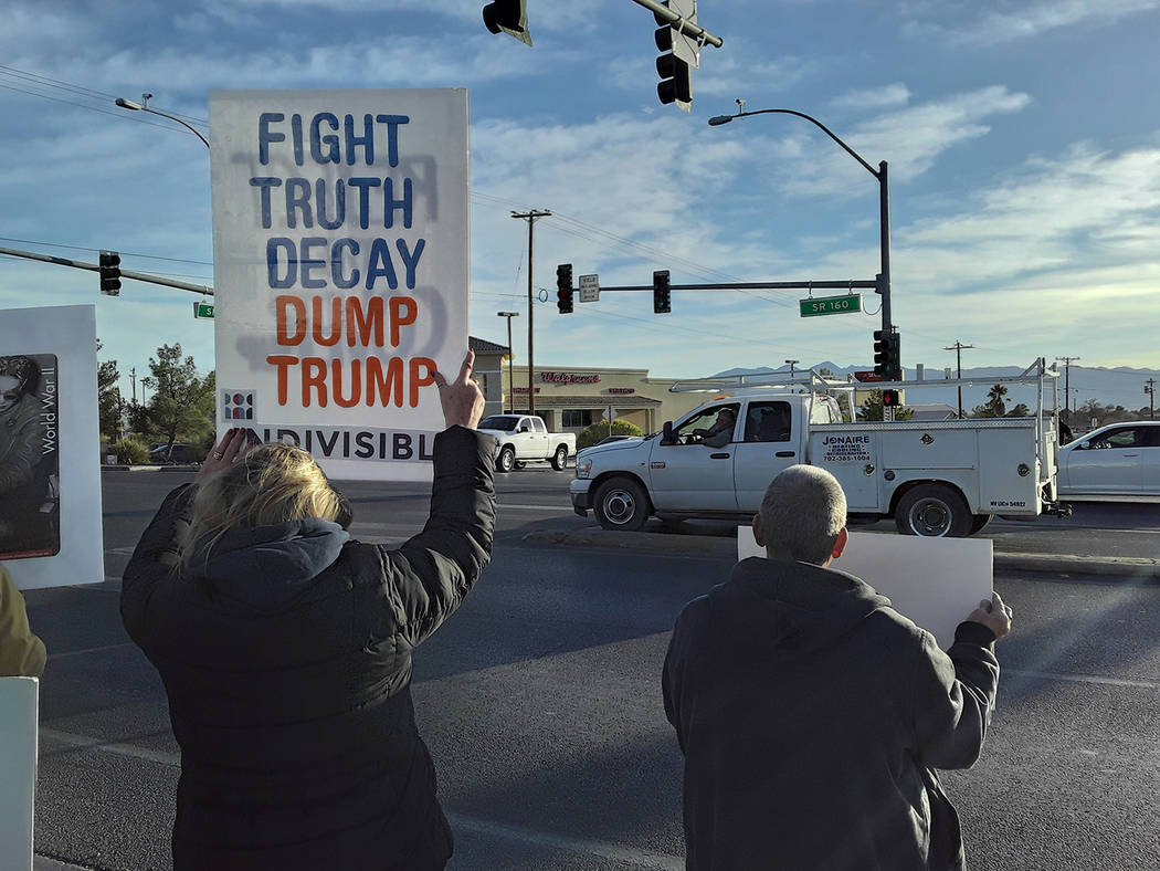 Selwyn Harris/Pahrump Valley Times A group of individuals opposed to President Donald Trump's i ...
