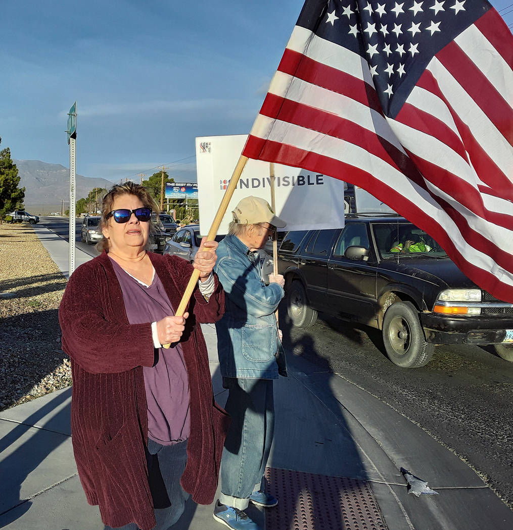 Selwyn Harris/Pahrump Valley Times While holding the American flag aloft, Pahrump resident DeDe ...