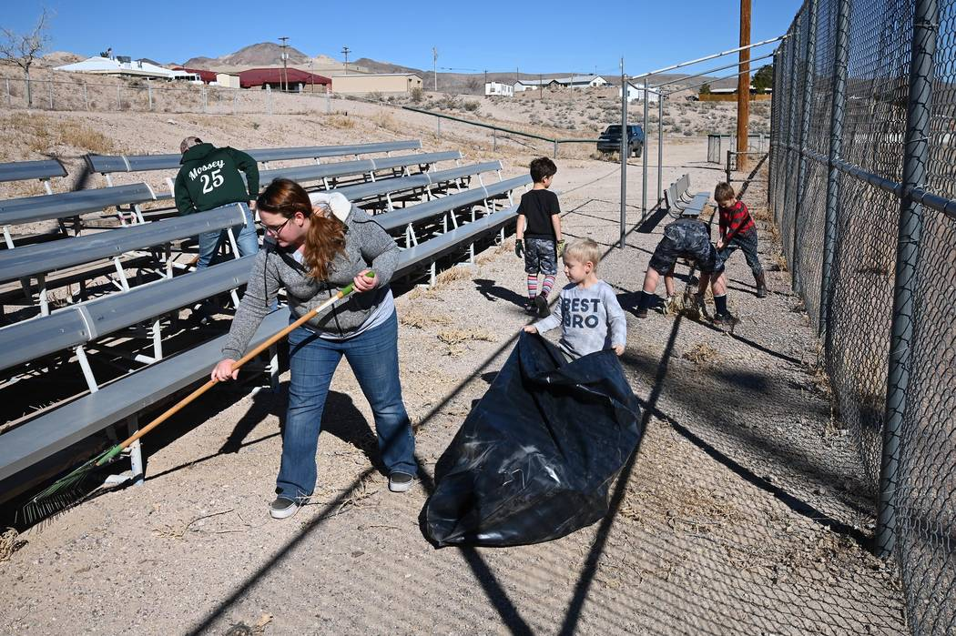 Richard Stephens/Special to the Pahrump Valley Times Volunteers help to clean up the area at Co ...