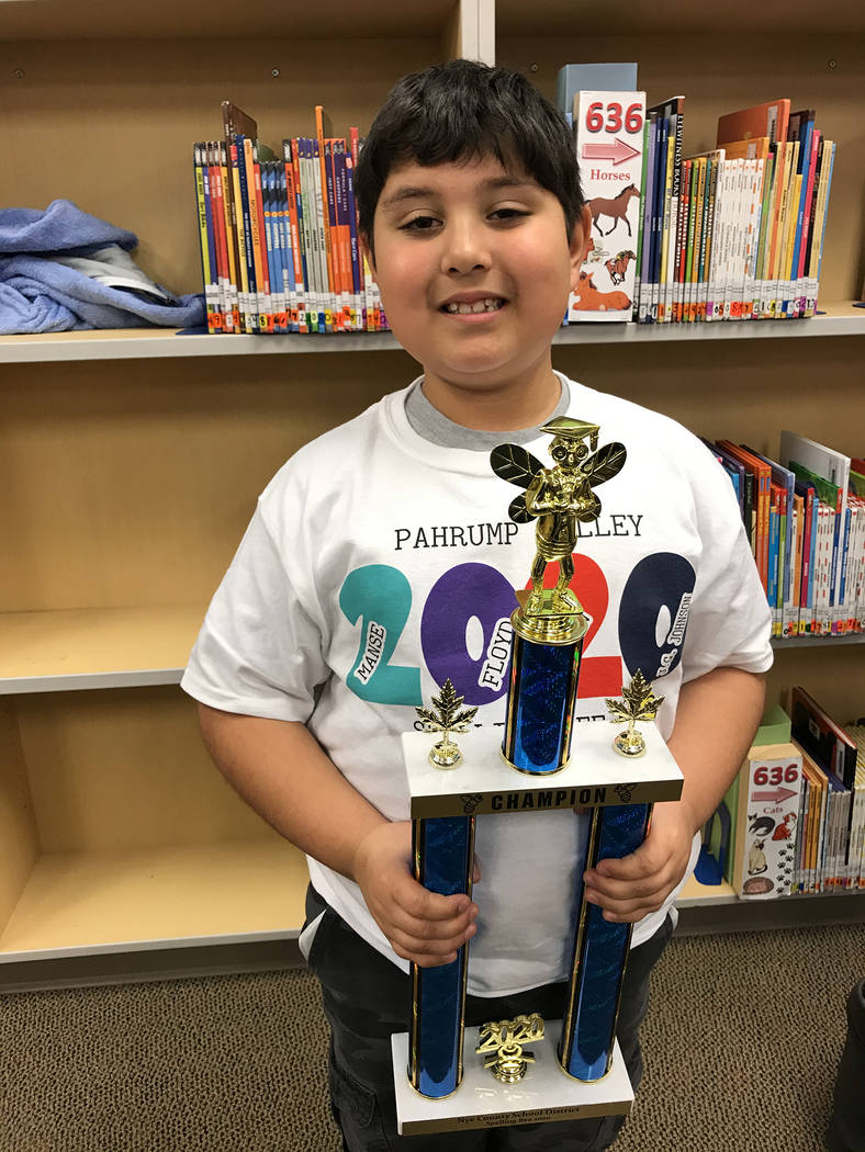 Robin Hebrock/Pahrump Valley Times A very proud Orion Deverse, a second grade student at J.G. J ...