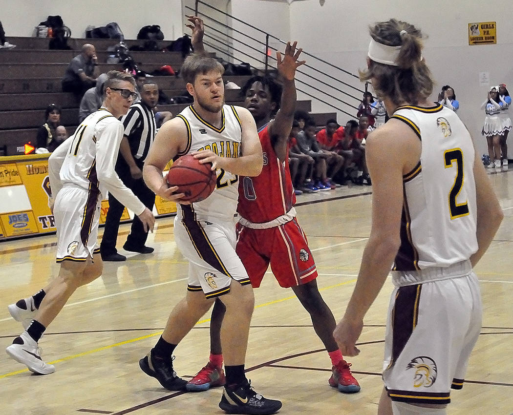 Horace Langford Jr./Pahrump Valley Times Senior Koby Lindberg looks to pass to fellow senior Ja ...