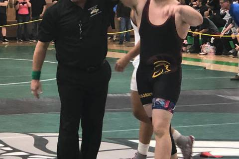 Tom Rysinski/Pahrump Valley Times Pahrump Valley junior Anthony Pearson's arm is raised after h ...