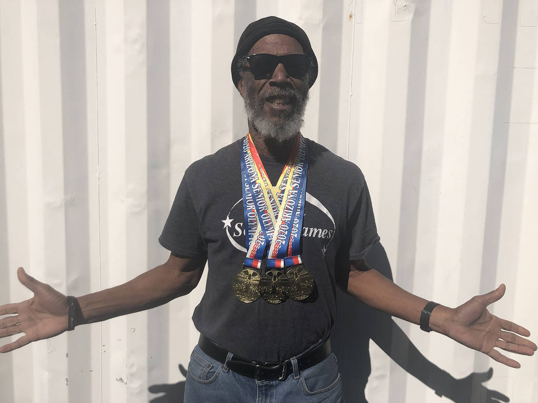 Tom Rysinski/Pahrump Valley Times Pahrump resident Marvin Caperton wears the three gold medals ...