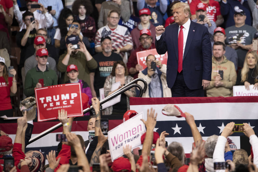 President Donald Trump gestures to supporters during a campaign rally, Monday, Feb. 10, 2020, i ...