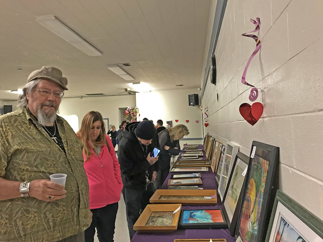 Robin Hebrock/Pahrump Valley Times Patrons are shown browsing through the wide variety of art a ...