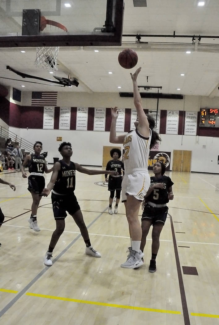 Horace Langford Jr./Pahrump Valley Times Junior Kate Daffer goes up for 2 of her game-high 24 p ...