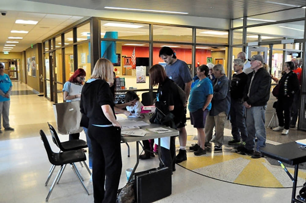 This file photo shows Nevada 2016 Democratic caucus participants signing in on caucus day. (Spe ...