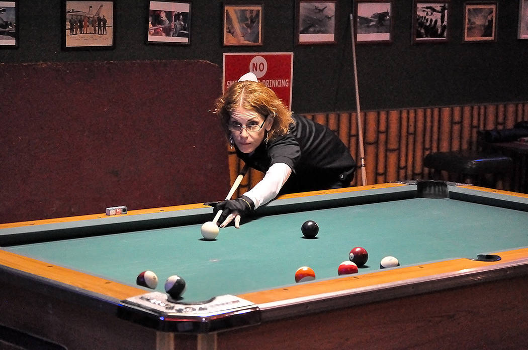 Horace Langford Jr./Pahrump Valley Times Rachelle Ryba lines up a shot during a home pool game ...