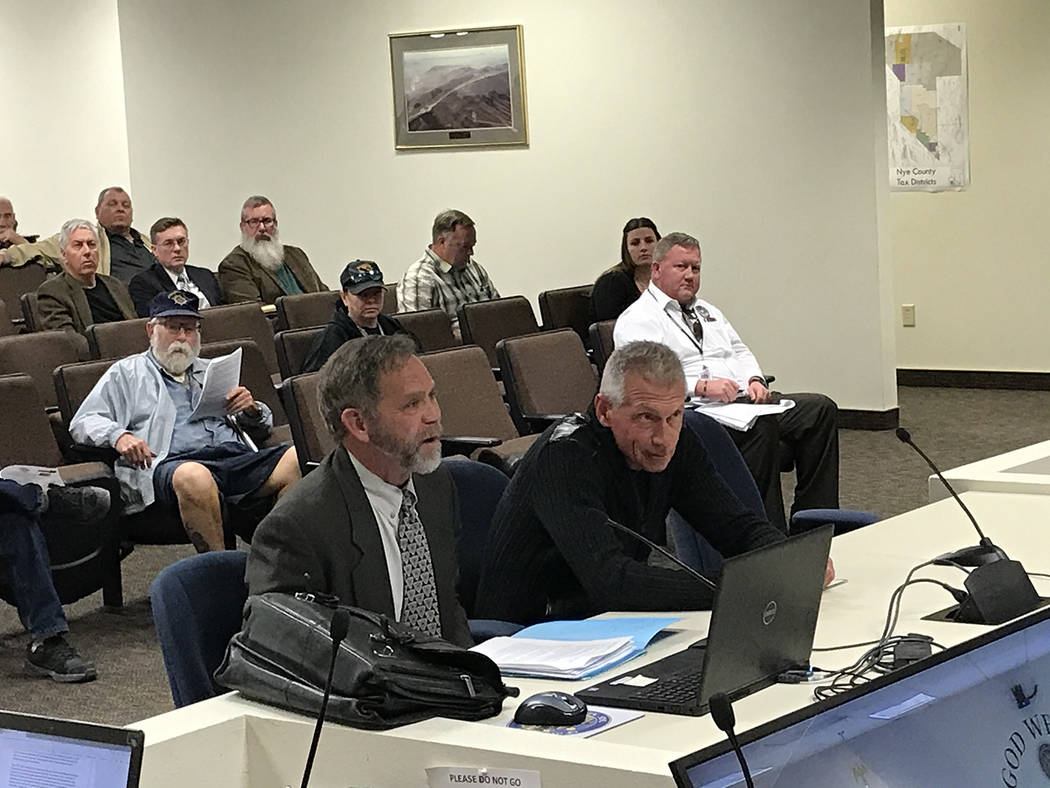Robin Hebrock/Pahrump Valley Times Attorney Tom Gibson, left, and commercial kennel operator Va ...