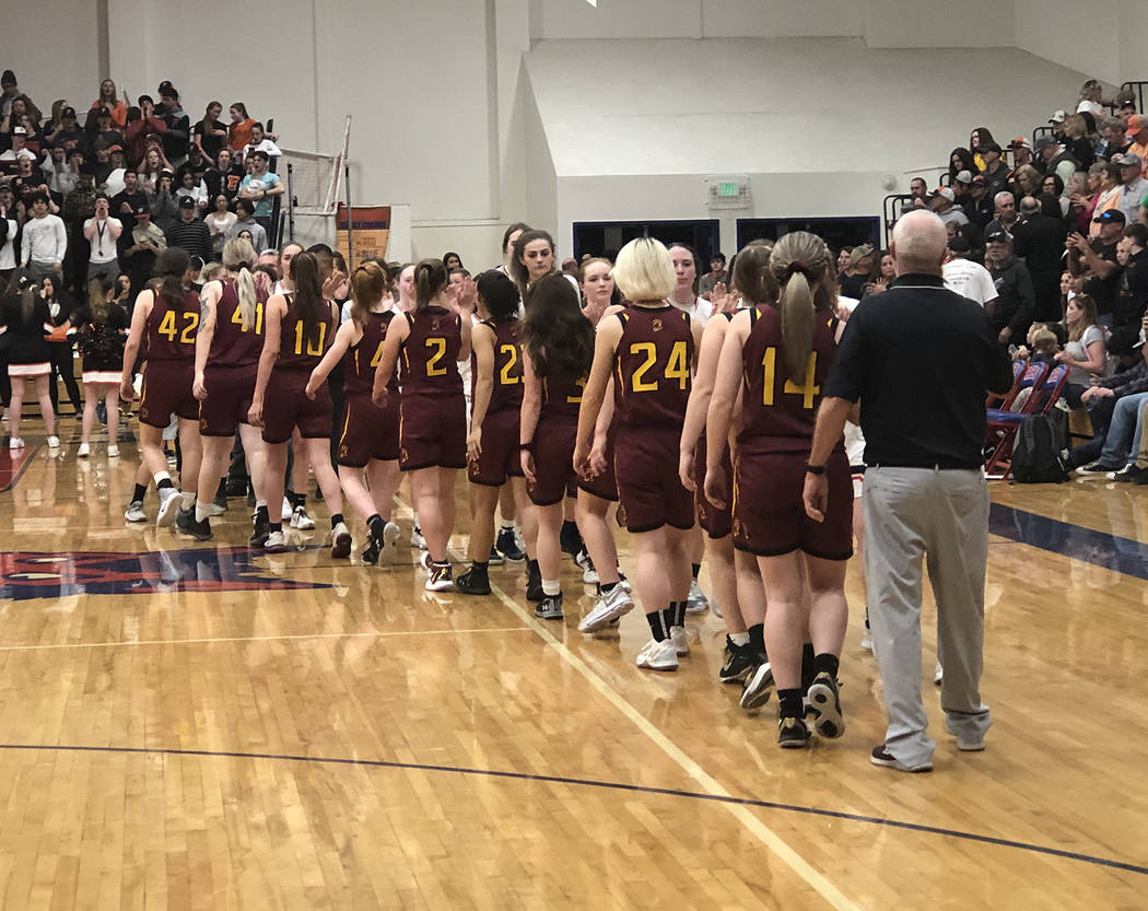 Tom Rysinski/Pahrump Valley Times Pahrump Valley High School girls basketball players line up t ...