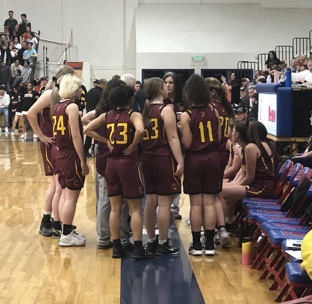 Tom Rysinski/Pahrump Valley Times Pahrump Valley High School girls basketball players gather ar ...