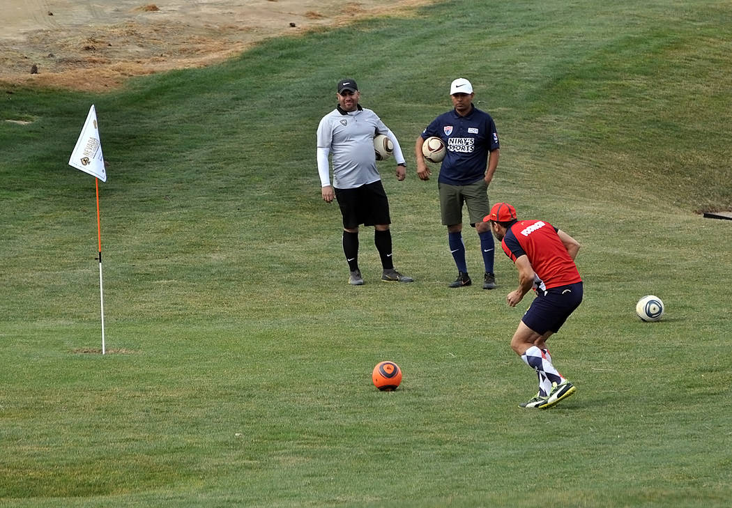 Horace Langford Jr./Pahrump Valley Times Footgolfers wait for one of their group to putt during ...