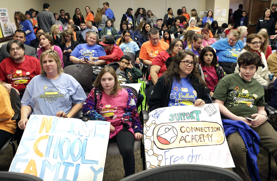 Kimberly King, left, her daughter Lacey, 9, Carly Held and her son Nathan, 14, supporting the o ...