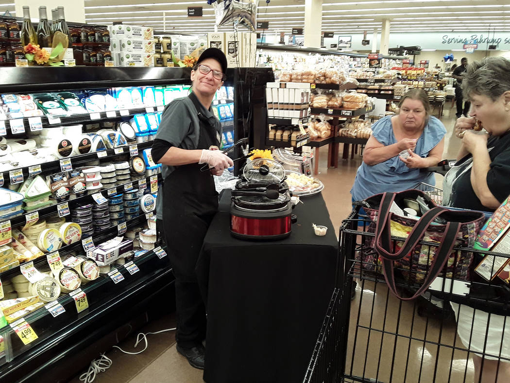 Selwyn Harris/Pahrump Valley Times Shoppers were treated to samples from the new hot food bar. ...