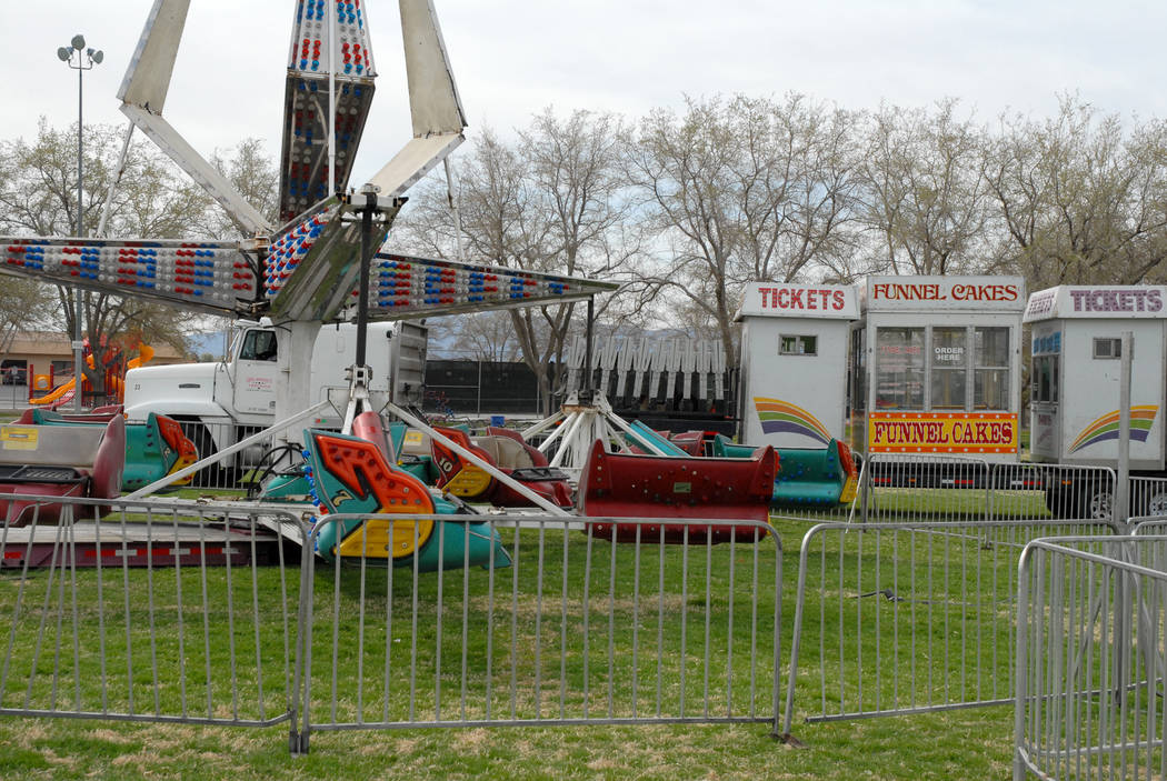 Horace Langford Jr. / Pahrump Valley Times - Davis Amusement carnival rides are trucked into pl ...