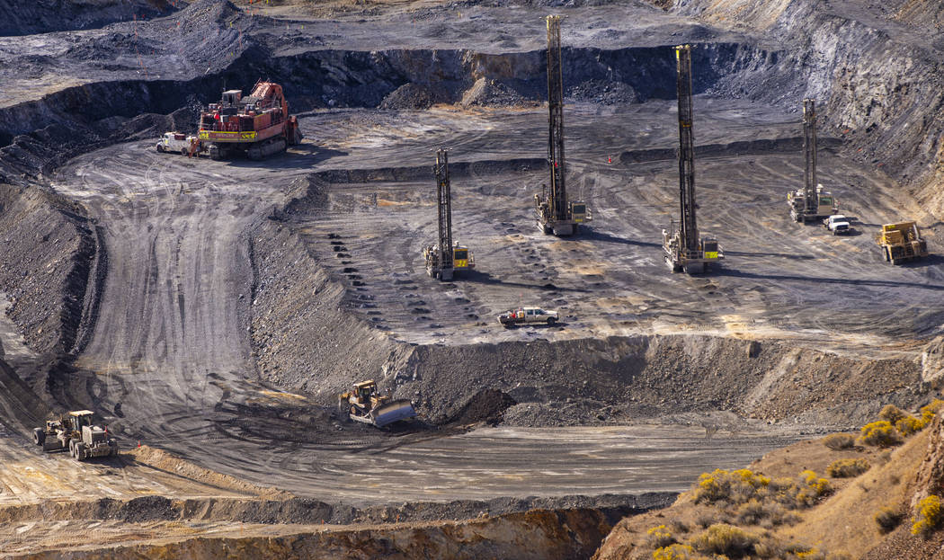 Workers make progress in open pit drilling in preparation to blast at Nevada Gold Mines' Carlin ...
