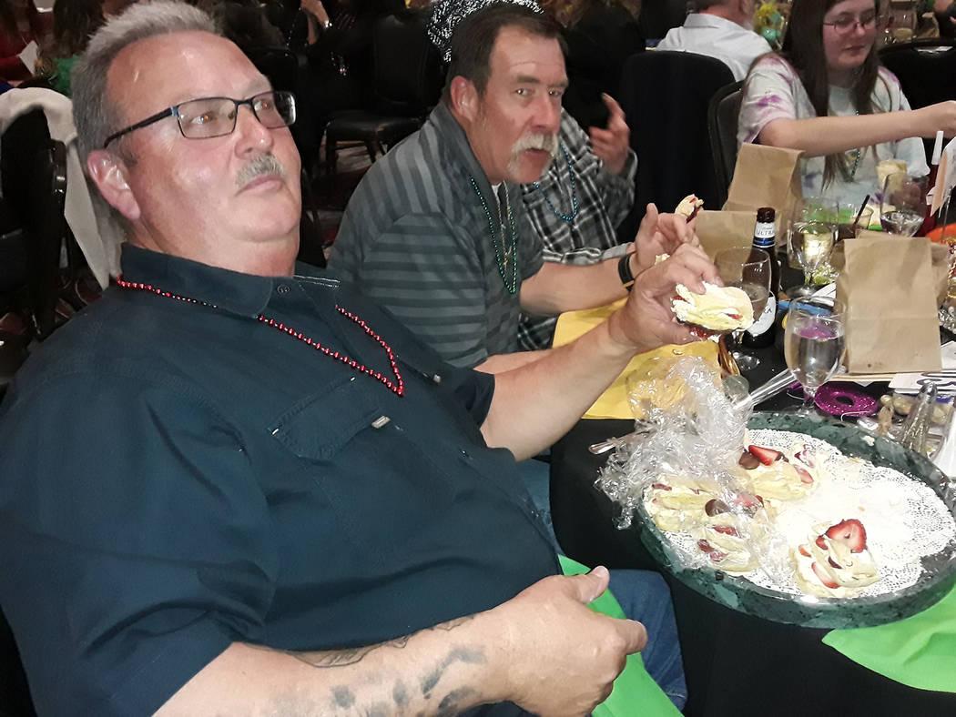 Selwyn Harris/Pahrump Valley Times Mardi Gras Ball attendees were served up a Cajun-style buffe ...