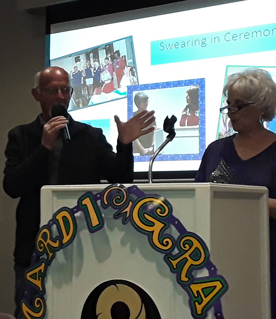 Selwyn Harris/Pahrump Valley Times Auctioneer Ski Censke, at left, is joined by Mardi Gras Coor ...