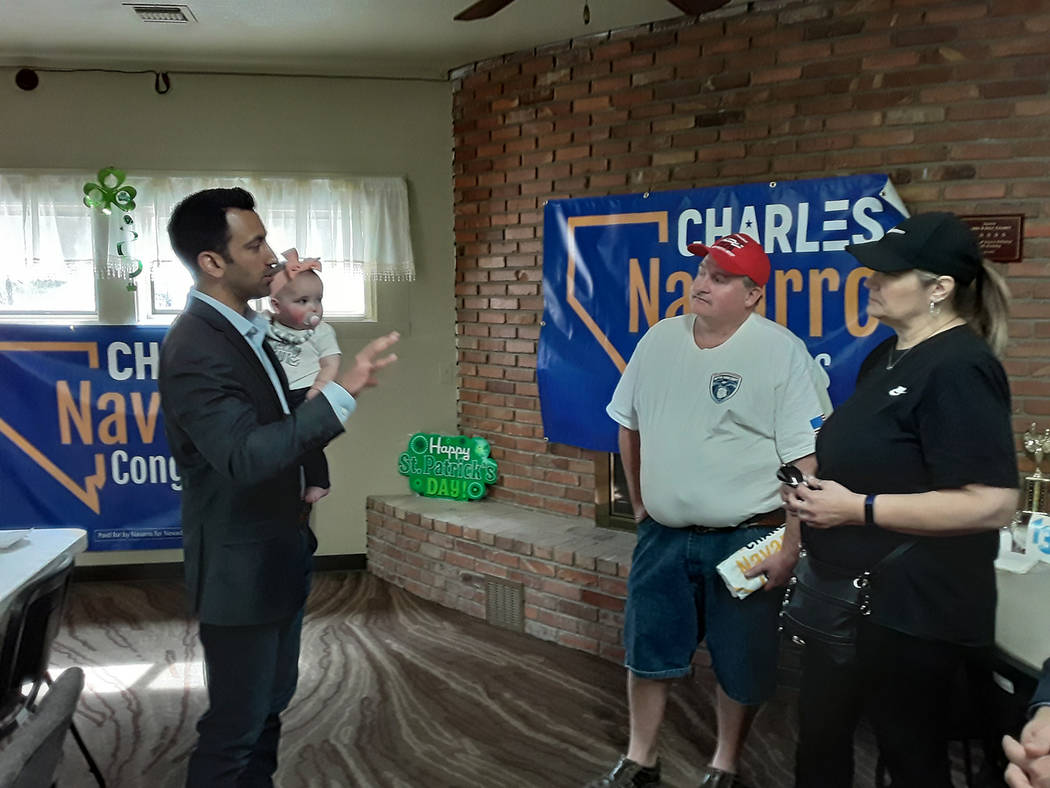 Selwyn Harris/Pahrump Valley Times Joined by his newborn daughter Reagan, Charles Navarro, a ca ...