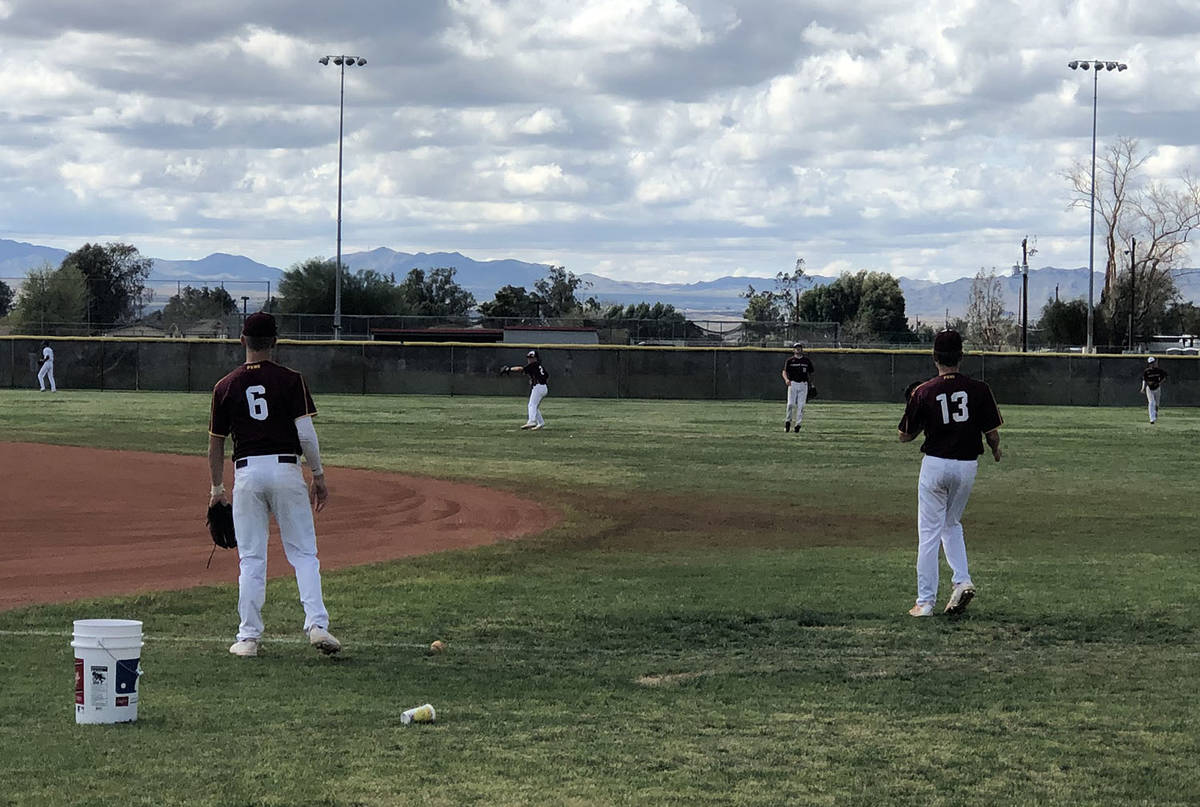 Tom Rysinski/Pahrump Valley Times Seniors Chase McDaniel, left, and Cyle Havel loosen up before ...