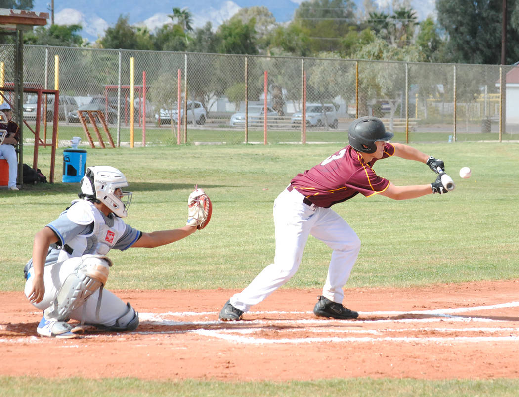Charlotte Uyeno/Pahrump Valley Times Junior Sterling Oshiro lays down a bunt during Pahrump Val ...