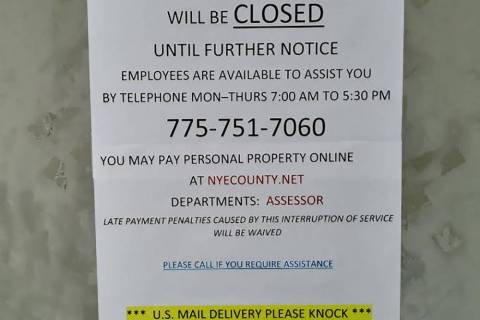 Selwyn Harris/Pahrump Valley Times A sign posted at the Nye County Assessor's Office on Monday, ...