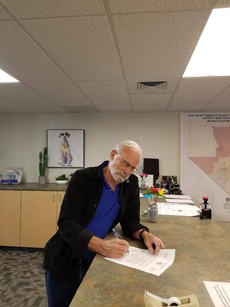 Special to the Pahrump Valley Times Nye County Commissioner John Koenig is shown filing for re- ...