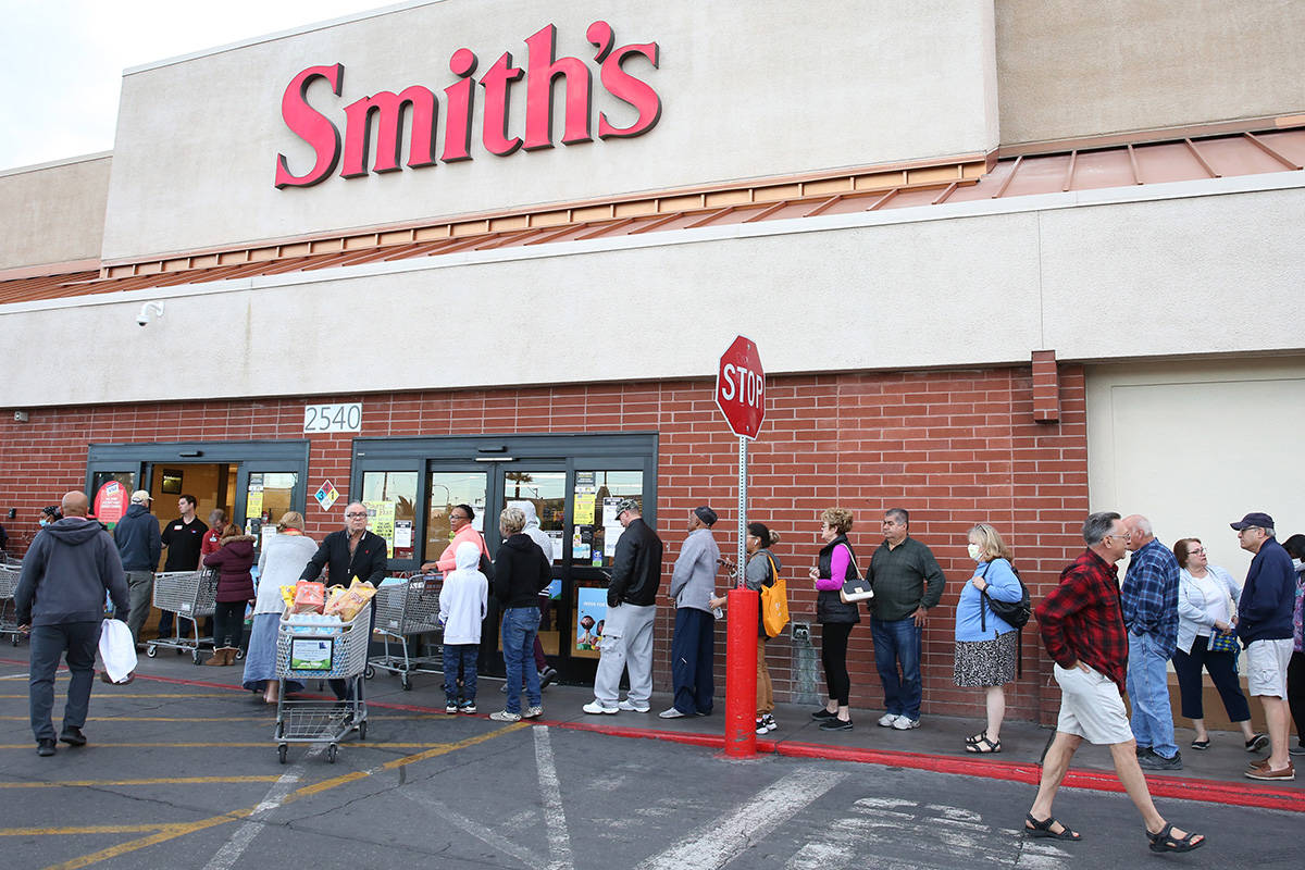 Seniors line up outside a Smith's store on Maryland Parkway on Wednesday, March 18, 2020, in La ...