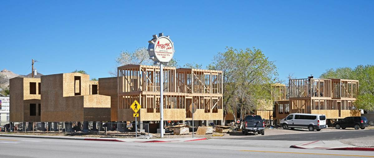 Richard Stephens/Special to the Pahrump Valley Times Construction crews work on a cluster of ti ...