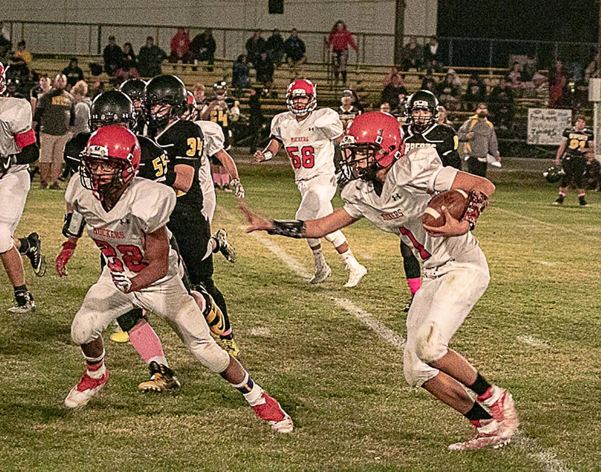 Times-Bonanza & Goldfield News file photo Junior quarterback Dillan Otteson looks for running r ...