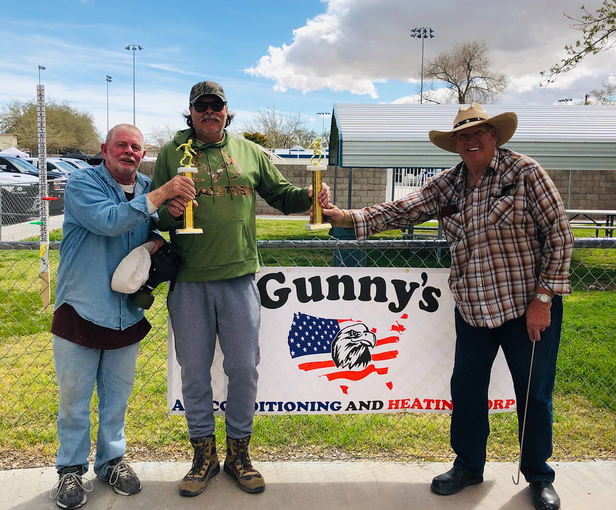 Cindy Barefield/Special to the Pahrump Valley Times Lathan Dilger, center, presents first-place ...