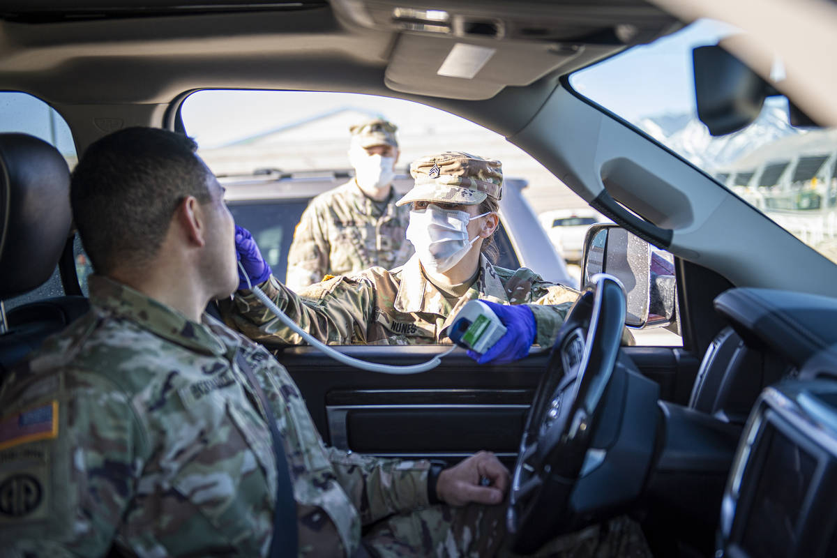National Guard/Sgt. Walter H. Lowell Staff Sgt. Jennifer Nunes, a health care specialist assig ...