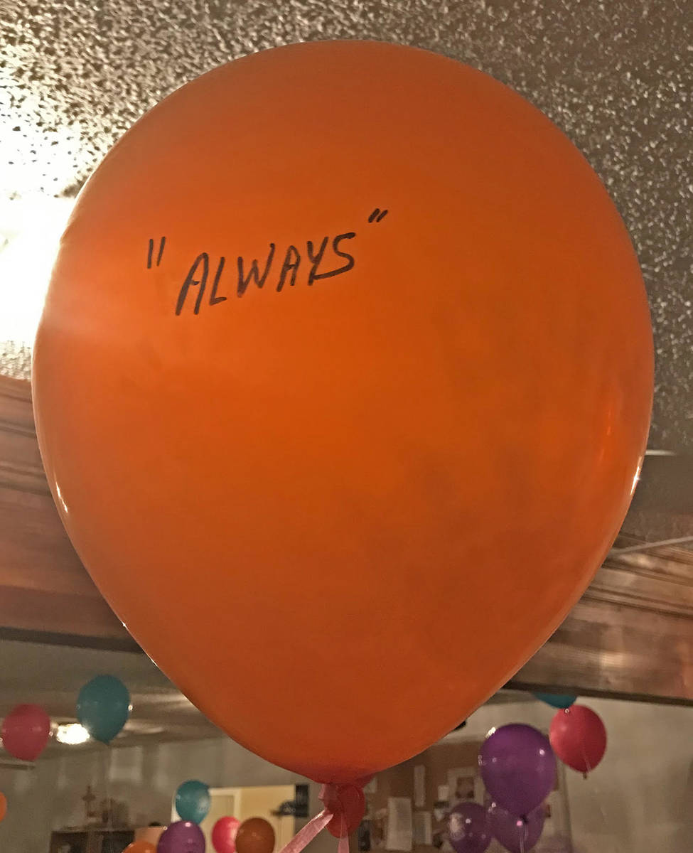 Robin Hebrock/Pahrump Valley Times A bright orange balloon was marked with a single loving word ...