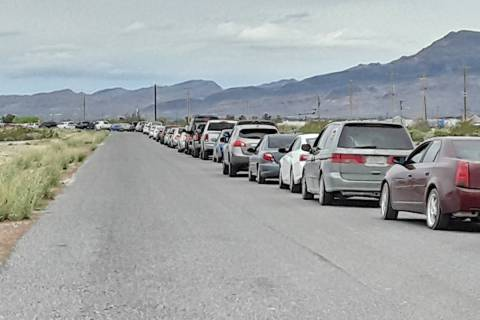 Selwyn Harris/Pahrump Valley Times Vehicles lined up from Raindance Drive off of Highway 372, a ...