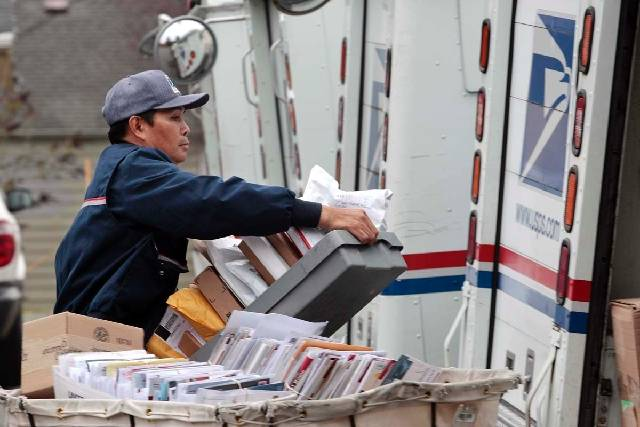 Las Vegas Review-Journal file If a delivery requires a signature, mail carriers will knock on ...