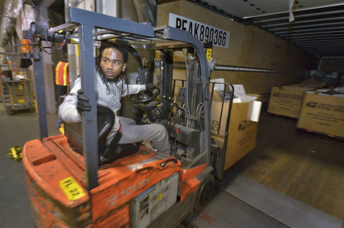 Bill Hughes/Special to the Las Vegas Review-Journal Mail handler Lovey Truss unloads a truck at ...