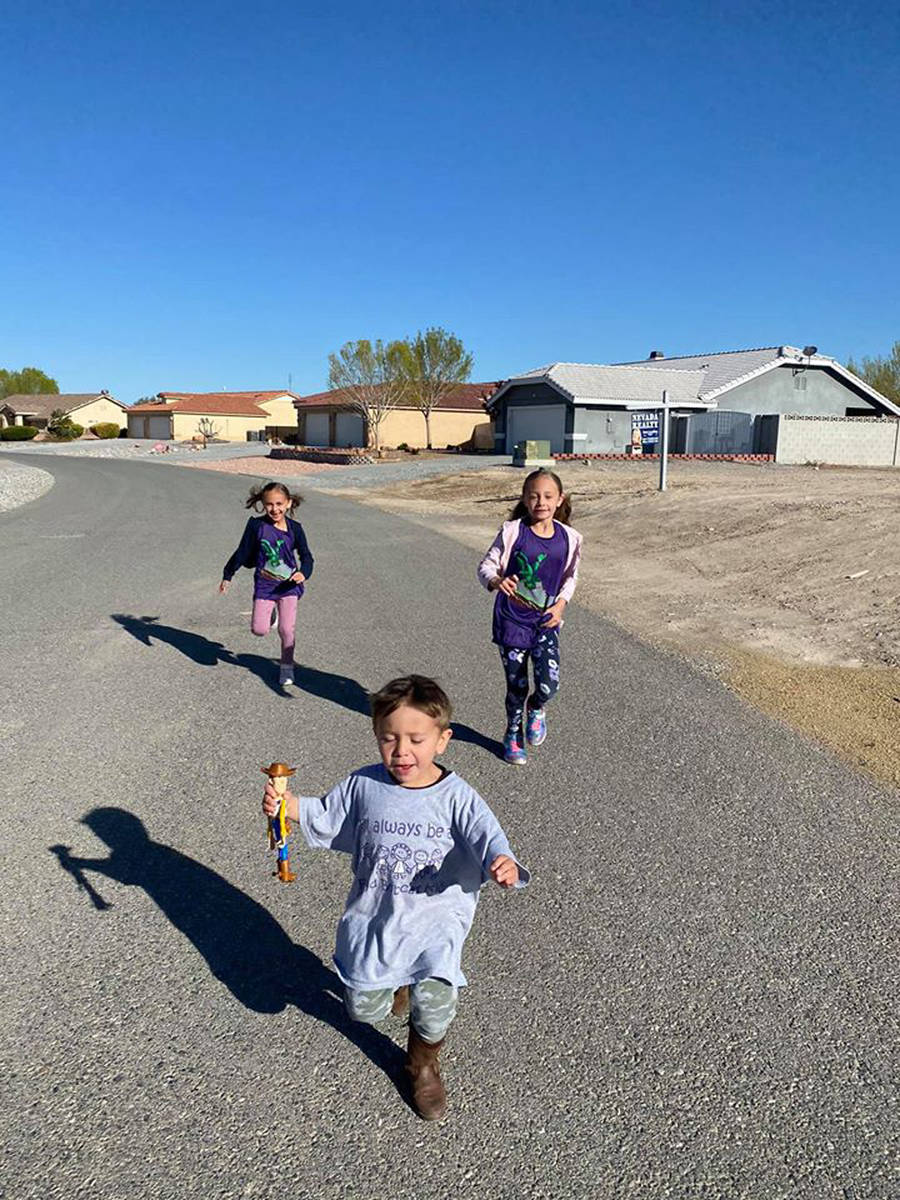 Special to the Pahrump Valley Times Dashing up and down the streets in their neighborhood, Jess ...