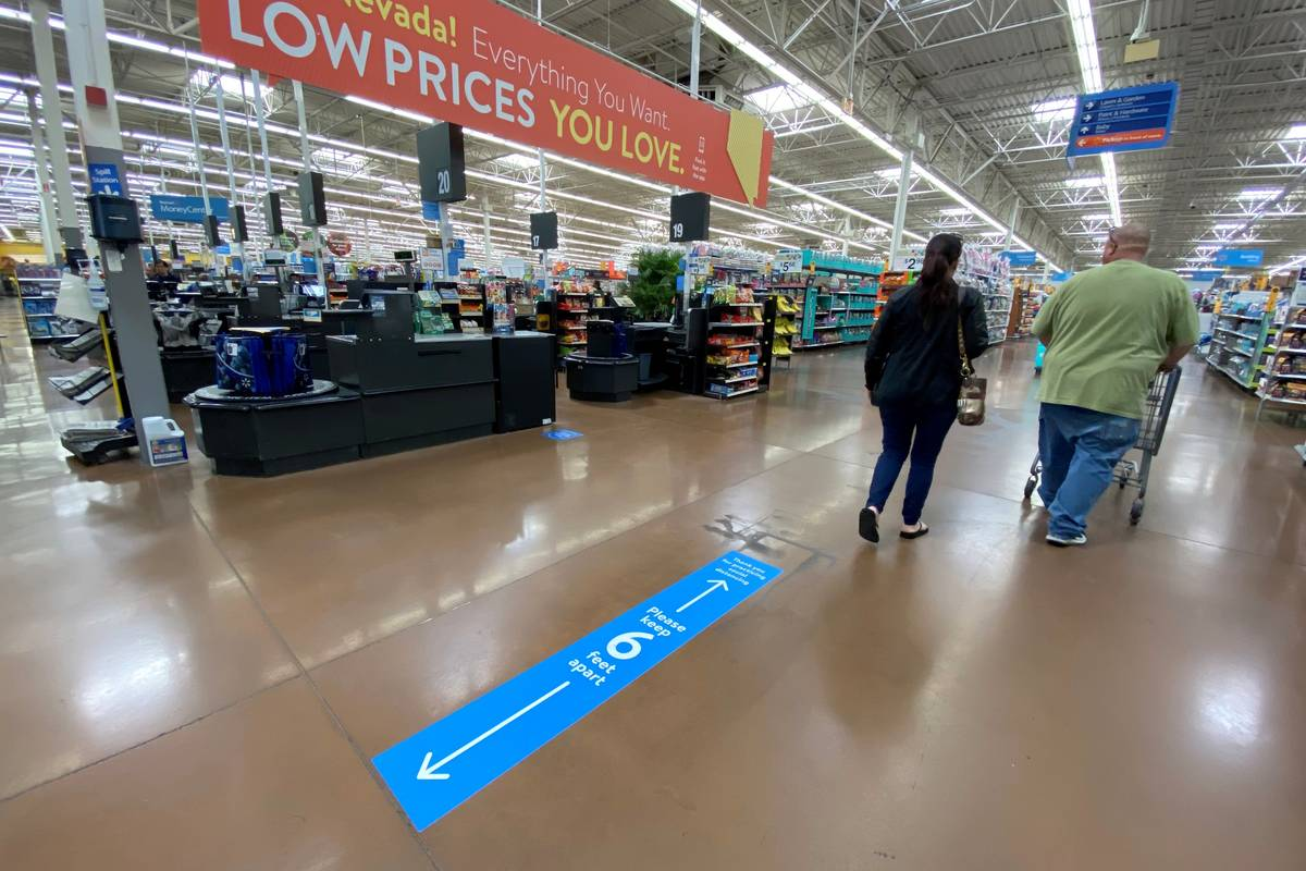 K.M. Cannon/Las Vegas Review-Journal Social distancing markings on the floor at Walmart Superce ...