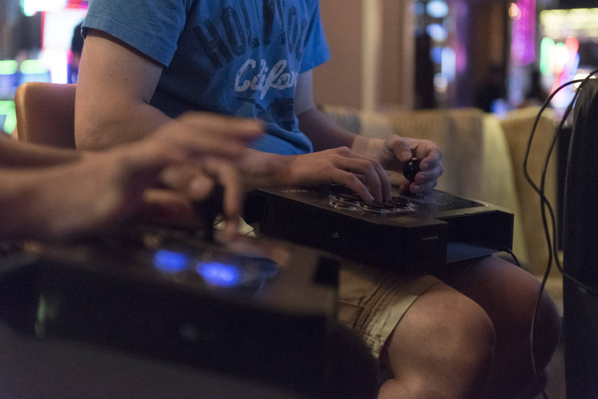 Jason Ogulnik/Special to the Pahrump Valley Times Quick hands compete in the Street Fighter V t ...
