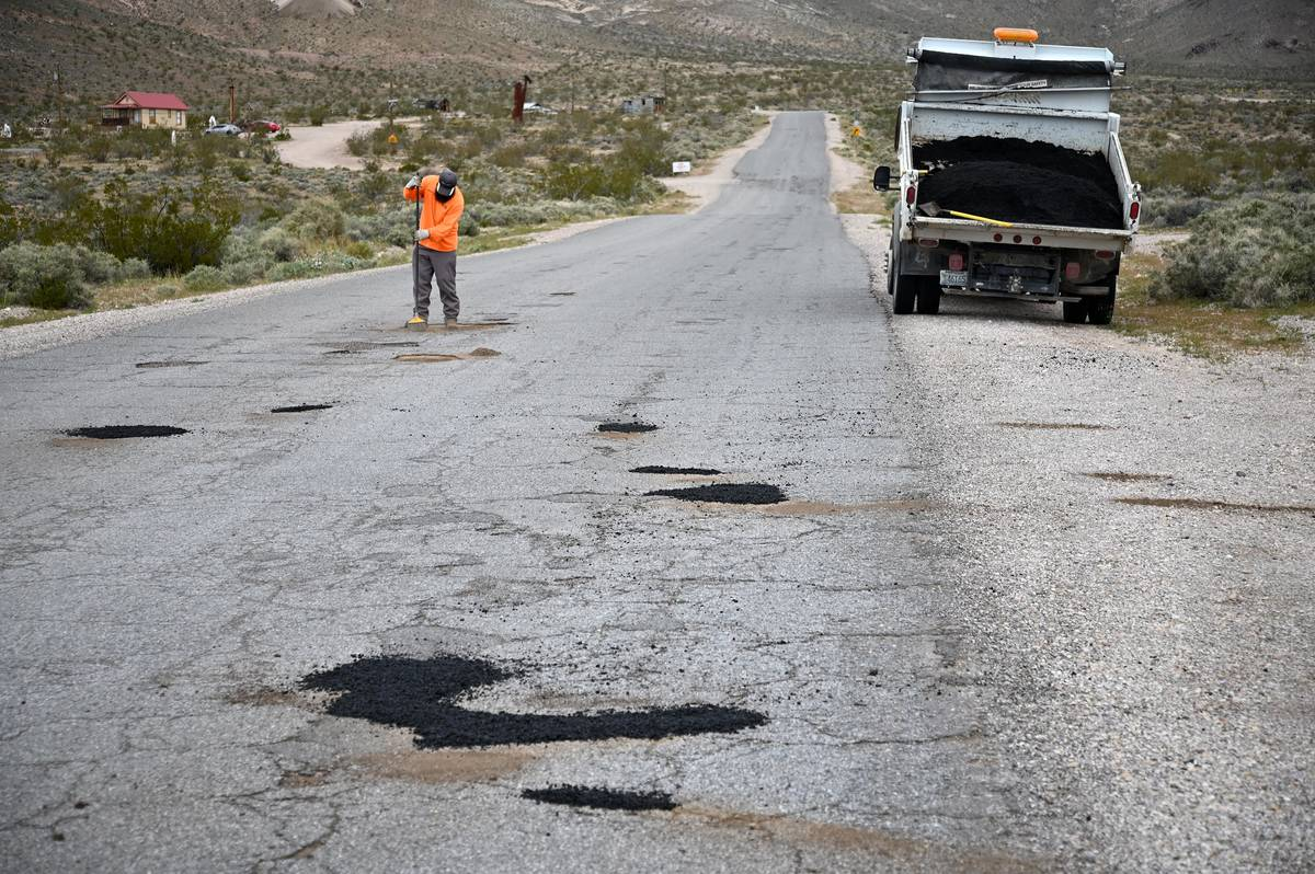 Richard Stephens/Special to the Pahrump Valley Times A road construction crewman works to patch ...