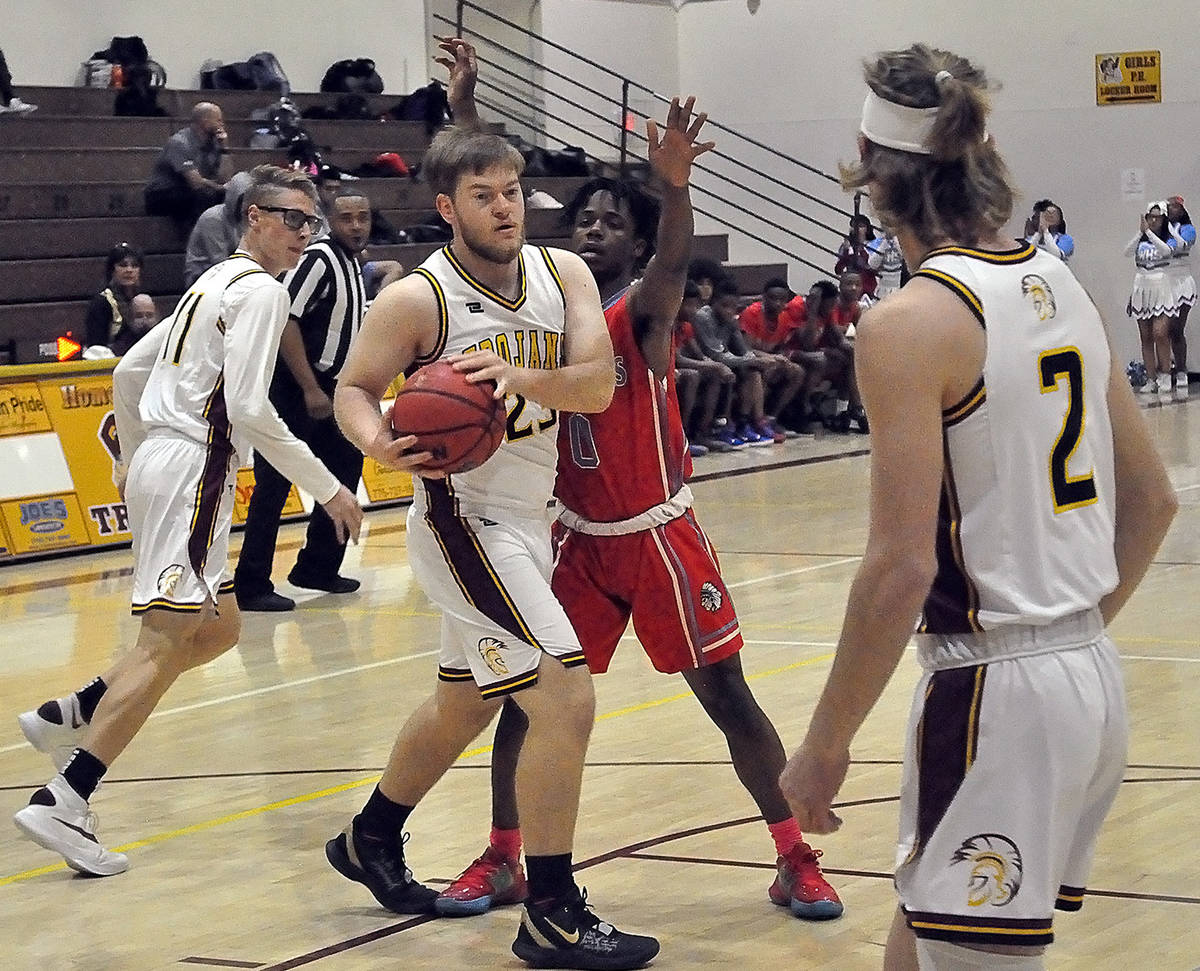 Horace Langford Jr./Pahrump Valley Times Koby Lindberg looks to pass to Grant Odegard (2) as Ka ...