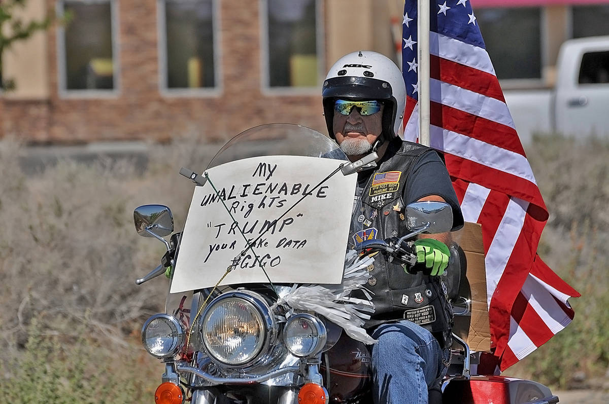 Horace Langford Jr./Pahrump Valley Times A local protester on his Harley showed his support fo ...