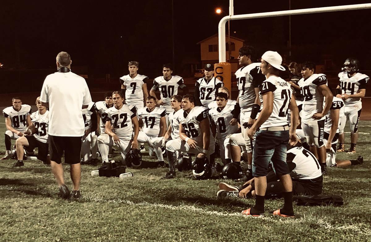 Tom Rysinski/Pahrump Valley Times file Pahrump Valley football coach Joe Clayton talks to his t ...