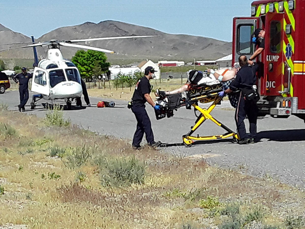 Selwyn Harris/Pahrump Valley Times Pahrump Valley Fire and Rescue Services medics prepare to tr ...