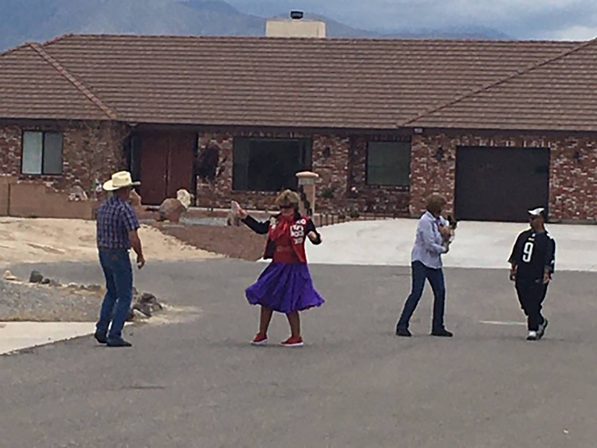 Special to the Pahrump Valley Times Neighbors join John and Janet Porn, pictured at left, for a ...