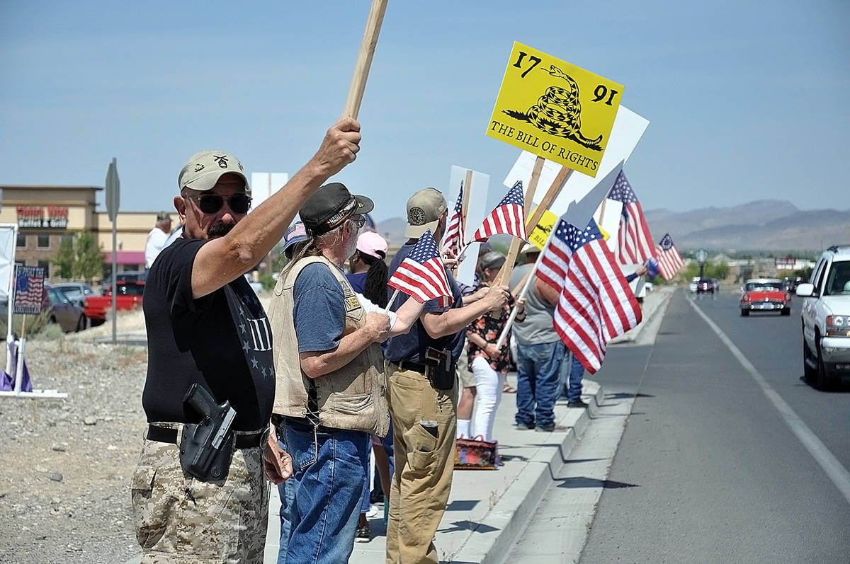 Horace Langford Jr./Pahrump Valley Times American flags and a variety of signs were hoisted int ...