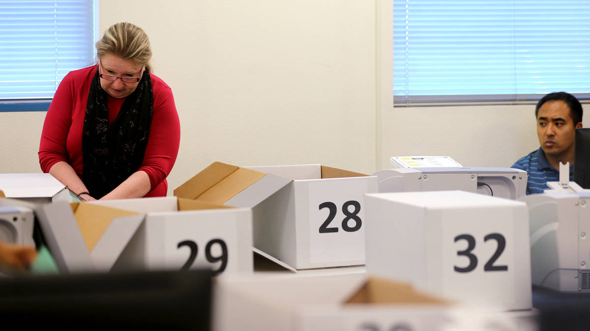 K.M. Cannon Las Vegas Review-Journal Clark County election workers count mail-in ballots durin ...