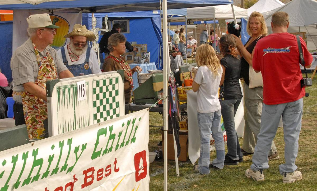 Richard Stephens/Special to the Pahrump Valley Times Festivalgoers enjoy the chili cook-off at ...