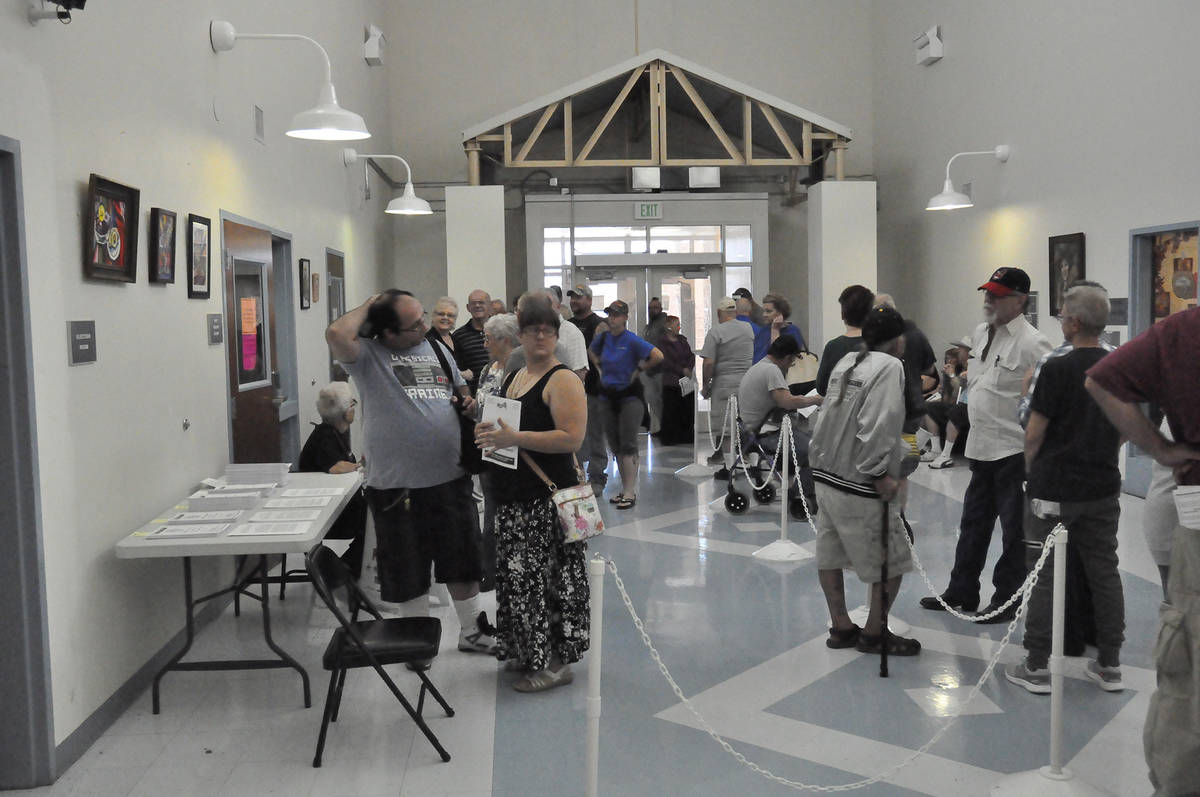 Voters line up outside of Nye County Clerk's Office at Ian Deutch Justice Complex on Saturday ...